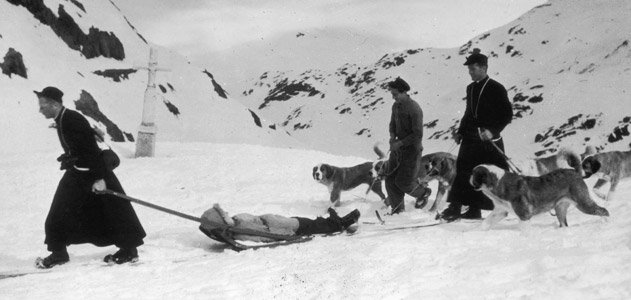 Monks and a team of St. Bernards rescue a lost traveler in the Swiss Alps, circa 1955. (George Pickow/Three Lions/Hulton Archive/Getty Images)